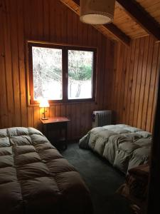 Una cama o camas en una habitación de Merihue