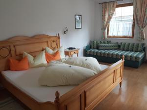 A bed or beds in a room at Apart-Garni Motnaida