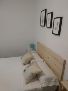Cama o camas de una habitación en Apartamentos Ciempozuelos