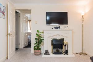 A television and/or entertainment center at 1 Bedroom apartment near Excel