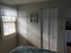 A bed or beds in a room at Oceanside Condos