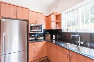 A kitchen or kitchenette at Ocean View Beach House