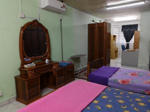 A bed or beds in a room at Homestay, Shah Alam