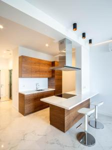 A kitchen or kitchenette at Apartments Barcelona-Park