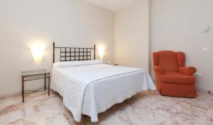 Letto o letti in una camera di Apartamentos Vértice Bib Rambla