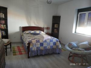 A bed or beds in a room at Casa Rústica II Rua das Flores