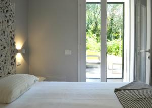 A bed or beds in a room at A Casa Mia