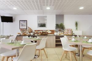 Restaurant ou autre lieu de restauration dans l'établissement Odalys City Beausoleil les Hauts de la Principauté
