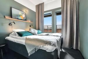 Łóżko lub łóżka w pokoju w obiekcie Forenom Aparthotel Oslo