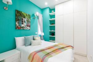 A bed or beds in a room at Apartamento Smile Sol