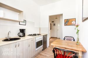 Kuchnia lub aneks kuchenny w obiekcie Upper Apart