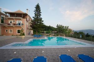 The swimming pool at or near Studios Vrionis Panoramic Sunset