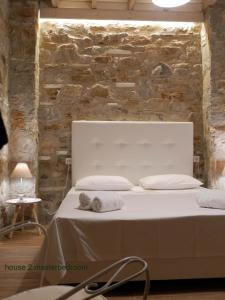 A bed or beds in a room at Elea Stone Houses in organic quiet olive grove, Prinos, Thassos