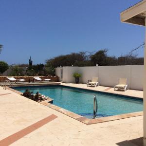 The swimming pool at or near La Dolce Vita Apartments