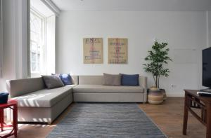 A seating area at Spot Apartments Casa Januario