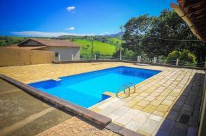 The swimming pool at or near chácara Rodrigues