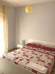 A bed or beds in a room at Villaggio Lamezia Golfo