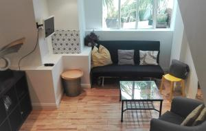 A seating area at Stylish studio with mezzanine 5 min to the tube