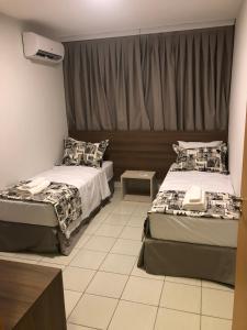 Ліжко або ліжка в номері Serra Madre Residence - Rio Quente - GO