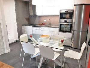 A kitchen or kitchenette at Seahorse Apartment