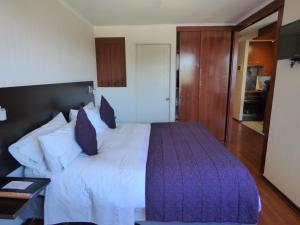 A bed or beds in a room at Altura Suites