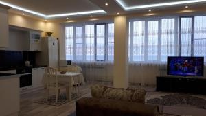 Гостиная зона в Apartment on Abubakarova 18