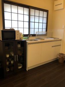 A kitchen or kitchenette at Nijyo Tsubakiya