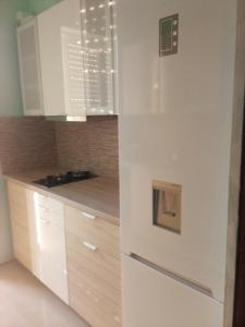 Кухня или мини-кухня в Rafina Port Paradise