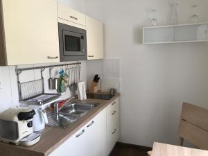 Küche/Küchenzeile in der Unterkunft Living Apart Leipzig