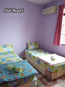 A bed or beds in a room at PD Perdana - Pidi Resort A108