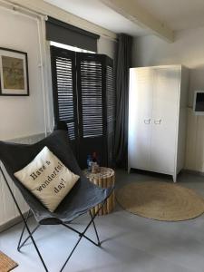 Een zitgedeelte bij Appartement 't Souterrain