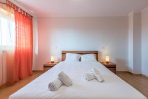 A bed or beds in a room at TPC - Daily Matters