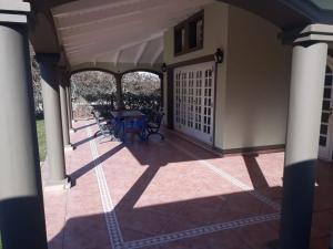 A balcony or terrace at Casa Quinta Las Violetas
