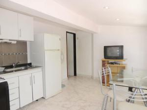 Una cocina o kitchenette en 3 bis