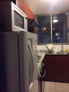 Una cocina o zona de cocina en Apartamentos en Santiago Centro