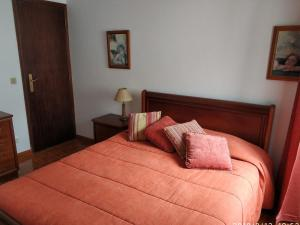 A bed or beds in a room at Costa House