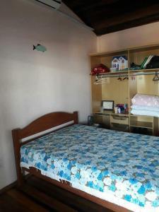 Cama o camas de una habitación en Casa 16 Pessoas 20m do mar 006