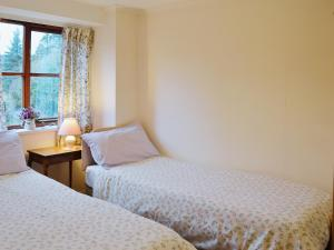 A bed or beds in a room at No 3 Tanyfford Barn
