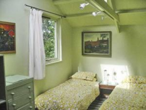 A bed or beds in a room at The Apple House