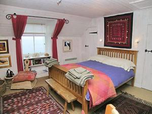 A bed or beds in a room at Weavers Cottage