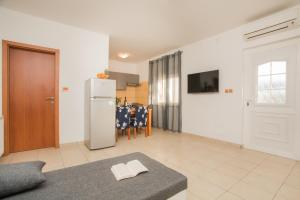 A television and/or entertainment center at Apartments Joy