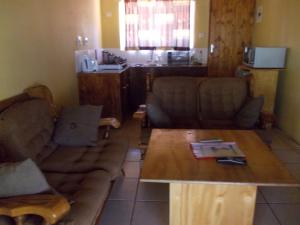 A seating area at African Sunsets (Bophirimo Self-Catering Guest House)
