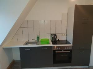 A kitchen or kitchenette at Centr Apartments Nürnberg