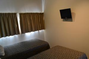 A television and/or entertainment center at Lufra Hotel and Apartments