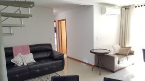 Zona de estar de Apartamento Duplex - Quadra do mar