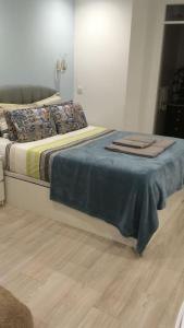 A bed or beds in a room at Maria Sardinha