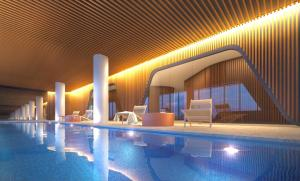 The swimming pool at or near Pride Docklands Waterfront Apartment City View