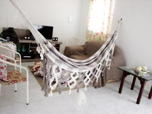 A seating area at Casa Aconchegante