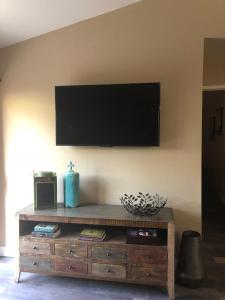 A television and/or entertainment center at Desert Oasis