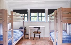 Våningssäng eller våningssängar i ett rum på Ljunghusen